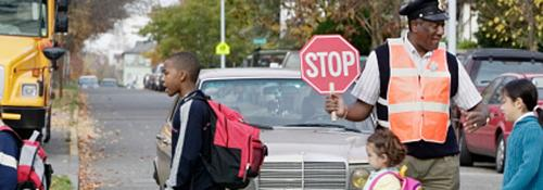 Crossing Guard Helping Students cross the road