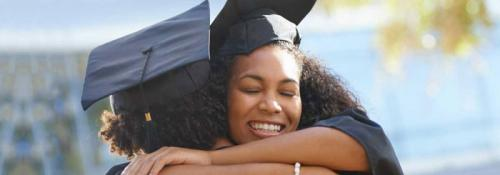 Graduates hugging in celebration