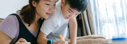 Mother and son working on school work