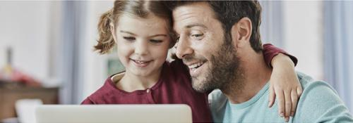 Father and daughter view tablet together