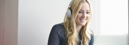 Person with headphones on attending webinar.