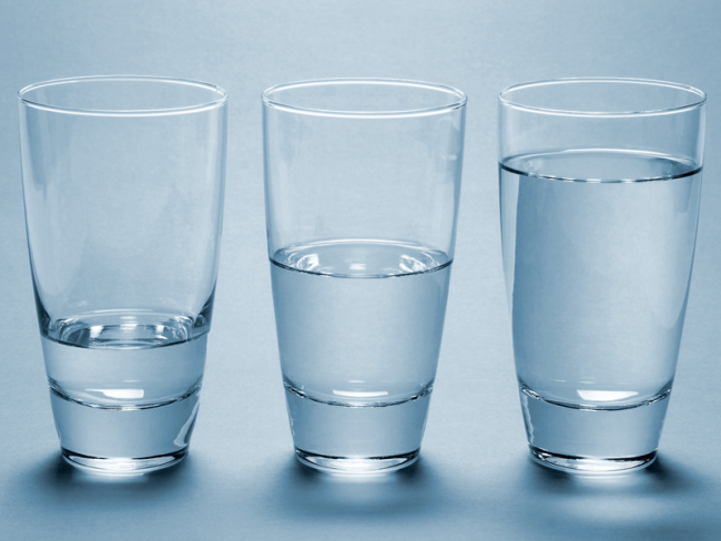 3 glasses with progressively larger levels of water.
