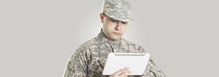 Soldier using tablet to access information