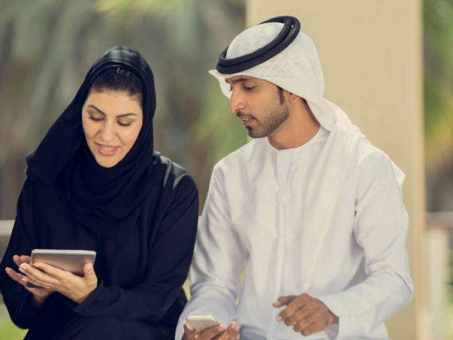 Man and woman looking at mobile device